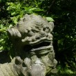 Japanese stone statue of a lion — Stock Photo