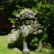 Japanese stone statue of a lion — Stock Photo #2094644