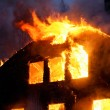 Stock Photo: Wooden house in flames