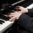 Hands of pianist playing on keys — Stock Photo #2111023