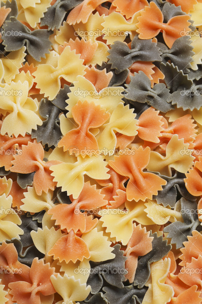 Three colored uncooked pasta texture — Stock Photo #2112462