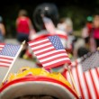 Stock Photo: 3 American flags in a parade