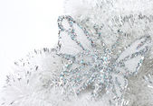 The butterfly on a tinsel — Stock Photo