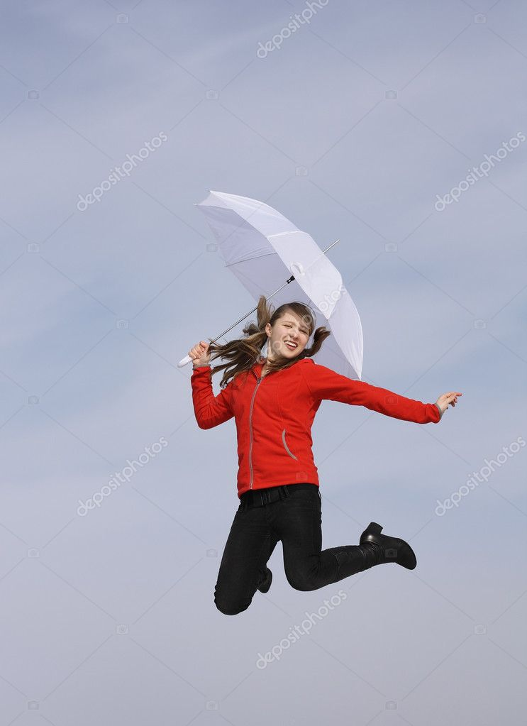 Girl with a white umbrella jumping against the sky — Stock Photo #2572549