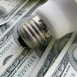 Lamp on dollars — Stock Photo #2554971