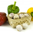 Bell peppers and basket with garlics — Stock Photo