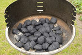 Coals in a grill — Stock Photo
