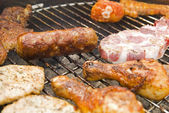 Beef and other meat on a barbecue — Stock Photo