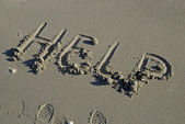 HELP written in sand — Foto Stock