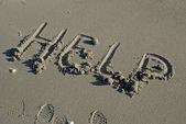 Pomoc w piasku — Zdjęcie stockowe