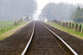 Railtrack with hazy crossing. — Stock Photo