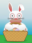 Easter Bunny Sitting With Basket of Eggs — Stock Vector