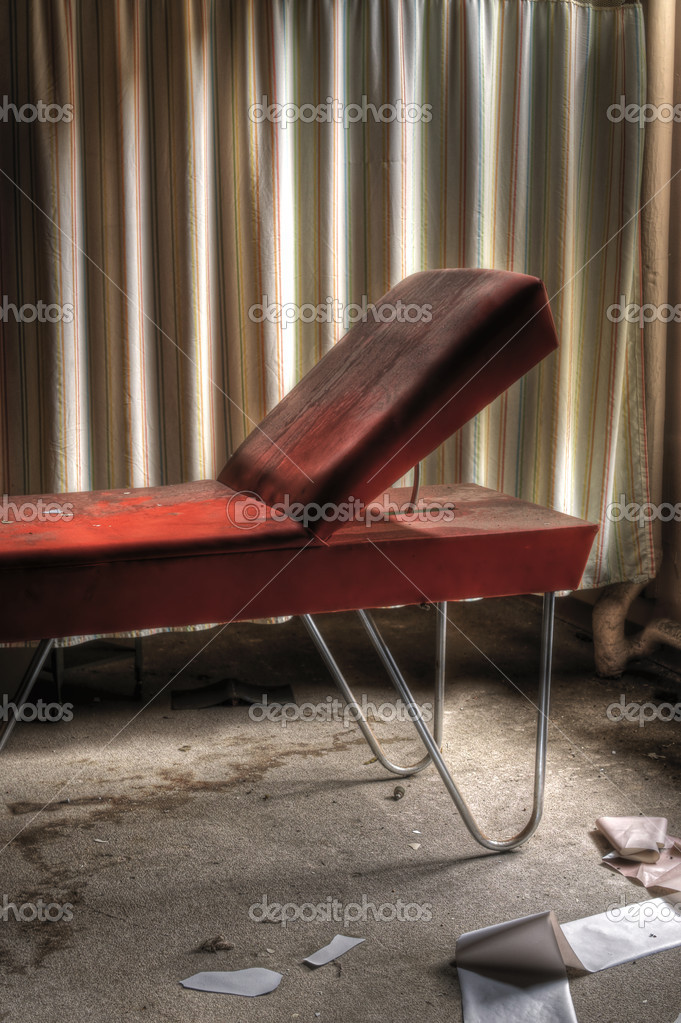 Orange Doctors Table in an Abandoned Hospital Room — Stock Photo #2126691