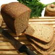 Bread still life with knife — Stock Photo