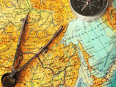 Map, compasses and compas — Stock Photo