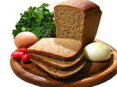 Bread cutting with parsley, tomato, egg, — Stock Photo