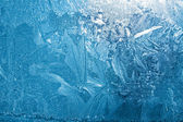 Frozen ice on window glass — Stock Photo