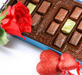 Box of chocolates, rose and heart — Stock Photo