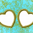 Gold heart-shaped frame on blue floral — Stock Photo