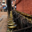 Temple candleholders at nepal - Stock Photo