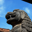 Ancient lion sculpture under blue sky - Stock Photo