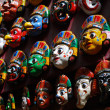 Stock Photo: Colorful wooden masks on the wall