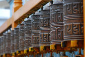 Tibetan Buddhism prayer wheels — Stock Photo