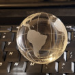 Globe on a laptop keyboard — Stock Photo