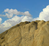 Artificial hill and clouds with backgraound of clound — Stok fotoğraf