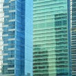 Contemporary office building blue glass wall detail — Stock Photo #2556069