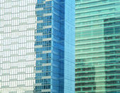 Contemporary office building blue glass wall detail — Stock Photo
