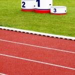 Track lanes with winner's podium — Stock Photo