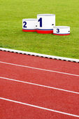 Track lanes with winner's podium — Stock Photo