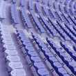 Several rows of blue plastic stadium sea — Stock Photo