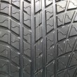Closeup texture of a car tyre - Stock Photo