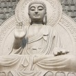 Stone Buddha Statue at temple in jinan, — Stock Photo