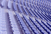 Several rows of blue plastic stadium sea — Stock Photo