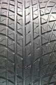 Closeup texture of a car tyre — Stock Photo