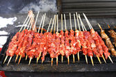 Closeup of shish kebab that is being gri — Stock Photo