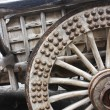Old, wooden, rustic wagon wheel — Stock Photo
