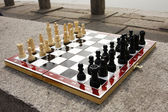 Chess board with chess figures ready to — Stock Photo