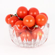 Cherry tomato in glass bowl — Stock Photo #2109958