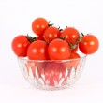 Cherry tomato in glass bowl — Stock Photo #2143921