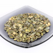Pumpkin seed on glass plate — Stock Photo #2143969