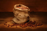 Coffee bag and coffee grains — Stock Photo