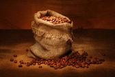 Coffee bag and coffee grains — Stock Photo