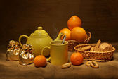 Teapot and oranges — Stock Photo