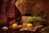 Wine, fruits and old maps — Stock Photo