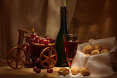 Wine and walnuts — Stock Photo