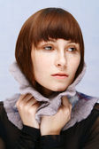 Calm girl with freckles in woolen collar — Stock Photo